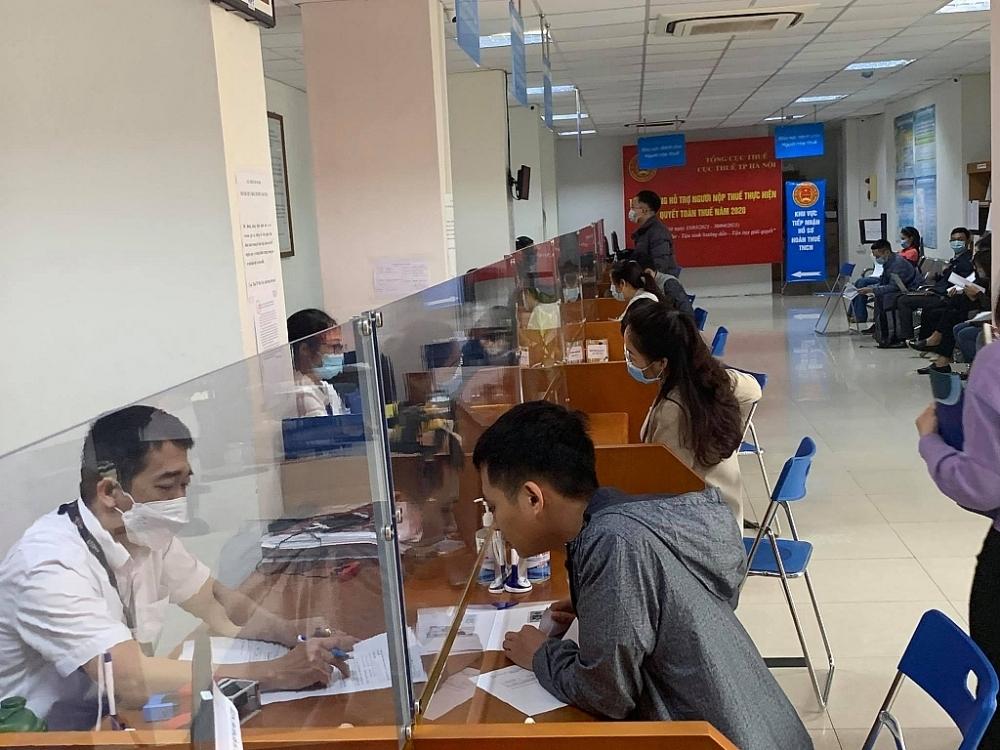 Hanoi recommends taxpayers go through procedures via electronic method or postal service