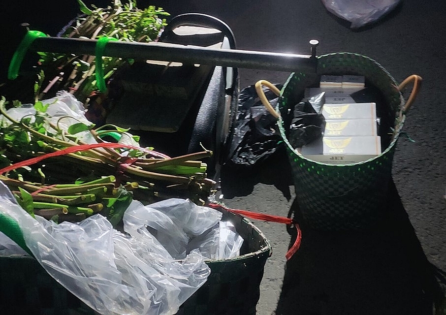 Smuggled cigarettes hidden inside packs of water spinach