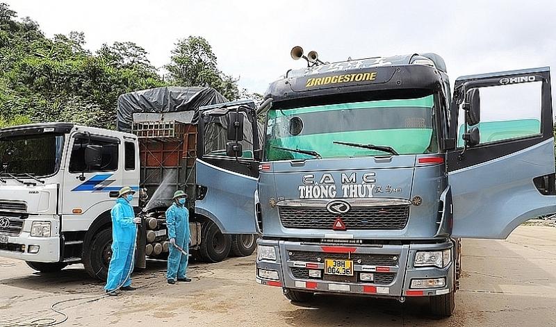 Trucks entering Cau Treo international border gate are disinfected. Photo: Phan Tram