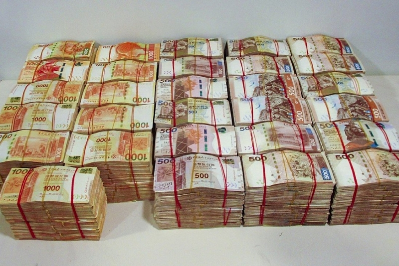 Cash seized in an operation that broke up a money-laundering ring engaged in smuggling criminal proceeds across the Hong Kong-Zhuhai-Macau Bridge. Photo: Handout