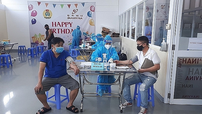 Workers at Tan Thuan EPZ, HCM City get the second dose of vaccine against Covid-19 on September 5, 2021. Photo: Hong Dao