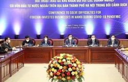 Hanoi: Accompany foreign investors to restore production and business