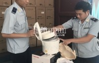 Binh Duong Customs detects a shipment of electric rice cookers in violation of origin