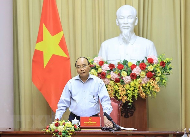 President hails garment sector for growth amid COVID-19 pandemic hinh anh 1