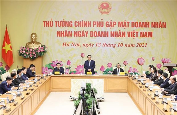Business community's trust, consensus demonstrate Government's responsibility: PM hinh anh 2