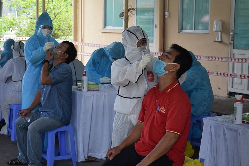 Medical workers take samples to test