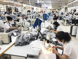 On reopening, Hanoi businesses are excited to catch up with production
